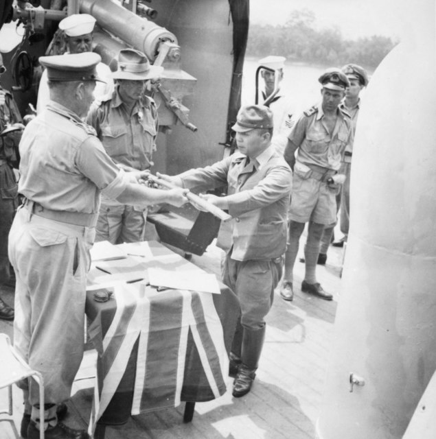 The official surrender ceremony of the Japanese to the Australian forces on board HMAS Kapunda at Kuching, Kingdom of Sarawak on September 11, 1945