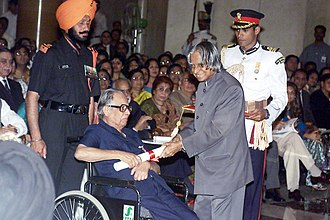 R. K. Laxman - The well-known political cartoonist for the 'Times of India' Shri R.K. Laxman receives the Padma Vibhushan award from the President Dr. A.P.J. Abdul Kalam in New Delhi on March 28, 2005