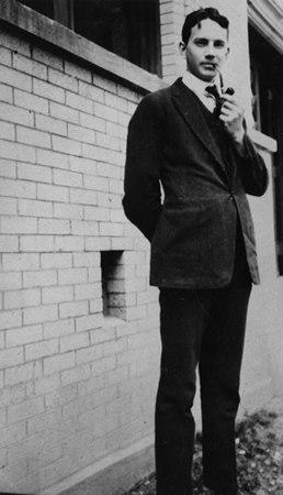Thomas Wolfe standing outside Vance Hall at the University of North Carolina, 1920