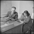 Topaz, Utah. Gilbert L. Niesse, Administrative Officer, is shown dictating to his evacuee secretary . . . - NARA - 537007.tif