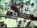 Tren Xitxarra en el depósito de Lorcha y la caseta donde se ubicaba la bomba de llenado del mismo.jpg