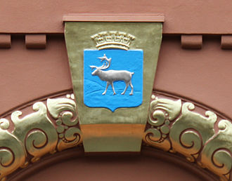 Tromsø - A relief of the arms on a 1910 façade.