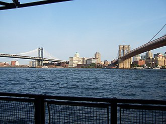 Two Bridges, Manhattan - The view of the East River and the Brooklyn Bridge and Manhattan Bridge from the East River Greenway running through Two Bridges, Manhattan