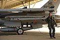 U.S. Air Force Capt. Matthew Dixon, a pilot with the 4th Fighter Squadron, inspects an F-16 Fighting Falcon aircraft before a mission at Hill Air Force Base, Utah, Oct. 17, 2013 131017-F-SP601-009.jpg