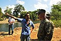 U.S. Marine Corps Master Gunnery Sgt. Lewis Martin, right, speaks with Tapuac Barangay Capt. Rafael Elamparo during a site assessment for a new foot bridge March 18, 2013, in Salaza village, Philippines 130318-N-FI367-046.jpg