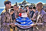 U.S. Marines and Sailors assigned to the 26th Marine Expeditionary Unit (MEU),and Sailors assigned to the USS Kearsarge (LHD 3), fold the American flag to commemorate the Fourth of July during their 2013 130704-M-BS001-001.jpg