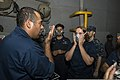 U.S. Navy Boatswain's Mate 1st Class Jose Rangel, left, conducts respirator fittings as Seaman Crystina Duvall, right, tests for airtight integrity of a respirator on the amphibious dock landing ship USS 131213-N-TQ272-063.jpg