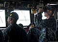 U.S. Navy Ensign Ben Ingersoll, right, the combat information center officer aboard the frigate USS Ford (FFG 54), searches the horizon during the ship's departure from Naval Station Everett, Wash., April 29 130429-N-QY316-125.jpg