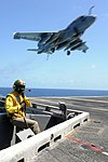 U.S. Navy Lt. Stephen Petres monitors the flight deck as an EA-6B Prowler aircraft assigned to Electronic Attack Squadron (VAQ) 140 prepares to land aboard the aircraft carrier USS Dwight D. Eisenhower (CVN 69) 130602-N-GC639-183.jpg