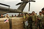 U.S. Navy Sailors and members of the Pakistan military load a MH-53E Sea Dr DVIDS11314.jpg