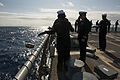 U.S. Sailors aboard the guided missile destroyer USS Gravely (DDG 107) conduct a during a burial at sea March 7, 2014, in the Atlantic Ocean 140307-N-DQ840-288.jpg