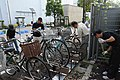 U.S. Sailors sweep around a bike rack during the monthly Yamato Train Station cleanup organized by the Yamato Soji Ni Manabu Kai in Yamato, Japan, Aug. 9, 2012 120809-N-QL603-078.jpg