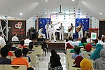 U.S. Sailors with the U.S. 7th Fleet Band's Pacific Ambassadors perform for Singaporean children at the Jamiyah Children's Home in Singapore June 11, 2013 130611-N-GR655-026.jpg