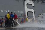 USS America deck scrubbing 140911-N-MZ309-041.jpg