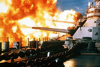 USS New Jersey (BB-62) - New Jersey opens fire on an enemy position off the coast of Beirut 9 January 1984.
