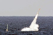 US Navy 030114-N-XXXXX-001 USS Florida launches a Tomahawk cruise missile during Giant Shadow in the waters off the coast of the Bahamas