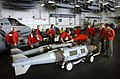 US Navy 030321-N-4953E-024 Aviation Ordnancemen move 2,000-pound Joint Directional Attack Munitions (JDAMs) from the weapon's magazine to the hangar bay of USS Harry S. Truman (CVN 75).jpg