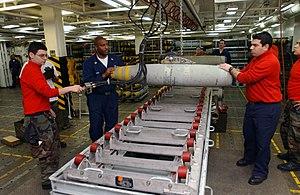 Magazine (artillery) - Image: US Navy 030327 N 1328C 519 Aviation Ordnancemen assemble bombs aboard USS Theodore Roosevelt (CVN 71)