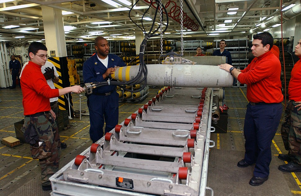 US Navy 030327-N-1328C-519 Aviation Ordnancemen assemble bombs aboard USS Theodore Roosevelt (CVN 71)