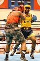 US Navy 030402-N-1485H-001 U.S. Navy boxing team member, Steelworker 1st Class Keith Spencer from Newark, N.J. (right) in the ring during a championship fight held during the National Boxing Tournament.jpg