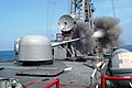 US Navy 030718-N-4178C-002 The 62 caliber three-inch gun aboard the guided missile frigate USS Curts (FFG 38) fires a projectile off the ship's port side.jpg