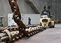 US Navy 030730-N-0683J-001 One of USS Abraham Lincoln's (CVN 72) anchor chains is removed with the aid of a forklift during a Planned Incremental Availability.jpg