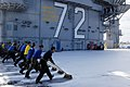 US Navy 040603-N-9593M-067 USS Abraham Lincoln (CVN 72) Aviation Boatswain's Mates perform a flight deck scrub following a counter-measures wash down test on the ship's flight deck.jpg