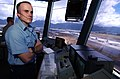 US Navy 040707-N-6932B-102 Air Traffic Controller 2nd Class Wesley Washabaugh observes as a helicopter approaches for landing at Marine Corps Base Hawaii.jpg