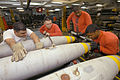 US Navy 040727-N-4190W-002 Members of G-3 bomb assembly division assemble a MK-82 500lb general-purpose bomb aboard USS John F. Kennedy (CV 67).jpg