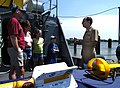 US Navy 040824-N-7676W-018 Cdr. Jerry Stefanko assigned to the Office of Naval Research (ONR) gives a tour to the Zolliger family during visiting hours aboard ONR's research vessel.jpg