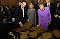 US Navy 050309-N-7676W-010 Tim Henkle explains a new flexible arm and leg protective armor for Soldiers and Marines to Senator Elizabeth Dole, (R-NC).jpg