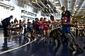 US Navy 060703-N-7130B-260 In the hangar bay aboard the Nimitz-class aircraft carrier USS Ronald Reagan (CVN 76), children of crew members play tug-o-war during a Tiger Cruise.jpg