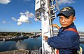 US Navy 070124-N-4965F-006 Electronics Technician 2nd Class Joseph Melchor, assigned to the Arleigh Burke-class guided-missile destroyer USS Paul Hamilton (DDG 60), climbs down the mast of the Paul Hamilton after completion of.jpg