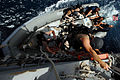 US Navy 070518-N-3284V-065 A visit, board, search and seizure (VBSS) team member lowers himself into a rigid-hulled inflatable boat from the guided-missile destroyer USS O'Kane (DDG 77).jpg