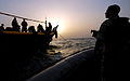 US Navy 070604-N-0684R-139 While conducting Interaction Patrols (IPATS), Boatswain's Mate 2nd Class Jared Klevens mans a .60-caliber machine gun as the visit, board, search and seizure (VBSS) team assigned to guided-missile des.jpg