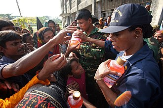Pedialyte - United States Navy personnel distributing Pedialyte to victims of Cyclone Sidr in Bangladesh