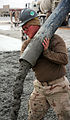 US Navy 080110-N-7367K-004 Builder 3rd Class Shawn Laborde, a Seabee with U.S. Naval Mobile Construction Battalion (NMCB) 1, Task Force Sierra, fills forms with fresh concrete.jpg