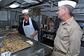 US Navy 080126-N-1113S-001 Vice Adm. Doug Crowder, right, talks with Culinary Specialist Seaman Emmauel Smith in the bakery aboard the amphibious command ship USS Blue Ridge (LCC 19).jpg