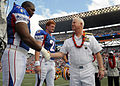 US Navy 080210-N-4965F-005 Adm. Timothy J. Keating, commander of U.S. Pacific Command, shakes hands with Washington Redskins offensive tackle Chris Samuels, before the coin toss of the 2008 Pro Bowl game at Aloha Stadium.jpg