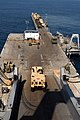 US Navy 080725-N-3038W-365 Equipment assigned to the 45th Sustainment Brigade and the 3rd Brigade Combat Team of the 25th Infantry Division rolls off the stern ramp of the Military Sealift Command large, medium-speed, roll-on-r.jpg