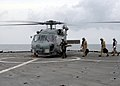 US Navy 080901-N-3392P-003 An SH-60B Sea Hawk conducts a passenger transfer.jpg