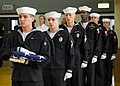 US Navy 081111-N-2013O-003 Sailors prepare to pass the flag during the Veterans Day ceremony at Fleet Activities Yokosuka.jpg