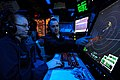 US Navy 081117-N-9950J-004 Air Traffic Controller 2nd Class Erin McHenry, of Wichita, Kan., and Air Traffic Controller Airman Apprentice Adam Minkel, of Pipestone, Minn., track aircraft on a radar console.jpg