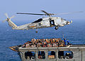 US Navy 081227-N-1082Z-050 An SH-60B Sea Hawk helicopter conducts a vertical replenishment with Military Sealift Command fleet replenishment oiler USNS Tippecanoe (T-AO 199).jpg