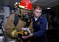 US Navy 090131-N-9520G-133 Senior Chief Damage Controlman Michael Kaszubowski, from Chicago, Ill., assigned to Afloat Training Group Western Pacific, advises a Sailor.jpg
