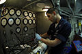 US Navy 090327-N-0096C-014 Aviation Structural Mechanic 2nd Class Brandon Fournier, from Fall River, Mass., tests an auxiliary power unit accumulator.jpg