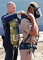 US Navy 090711-N-5207L-102 Damage Controlman Fireman Jason Hazenfield, assigned to the guided-missile frigate USS Crommelin (FFG 37), helps a Royal Thai Navy sailor don a self-contained breathing apparatus (SCBA) during a damag.jpg