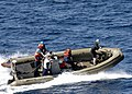 US Navy 090712-N-2013O-081 Sailors stationed aboard USS George Washington (CVN 73) practice high speed turns on a rigid hull inflatable boat during a small boat operations drill.jpg