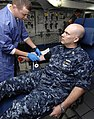 US Navy 090728-N-3793B-001 Hospitalman Jeremy Wyche draws blood from Chief Interior Communications Electrician Donivan Marlin during a blood drive aboard the aircraft carrier USS Harry S. Truman (CVN 75). Truman is at homeport.jpg