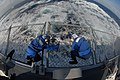 US Navy 090930-N-1688B-140 Sailors aboard the guided-missile destroyer USS Cole (DDG 67) take advantage of a break during flight quarters to repair a hole in the safety netting around the flight deck.jpg